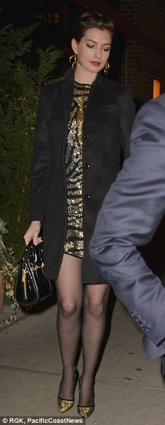 Gorgeous in gold: The Princess Diaries star modeled a lovely gold and black mini dress in leopard print
