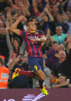 Alexis Sanchez of FC Barcelona celebrates after scoring his team's second goal during the La Liga match between FC Barcelona and Real Madrid CF at Camp Nou stadium on October 26, 2013 in Barcelona, Catalonia.