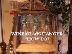OMG, how ridiculously easy is this?  Use wood floor transition pieces to make a wine glass holder.