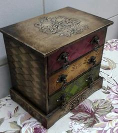 I like the stencil on top and the different colored drawers on this piece.