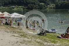 People on the beach and swimming in the Lake in Roznow in Poland .