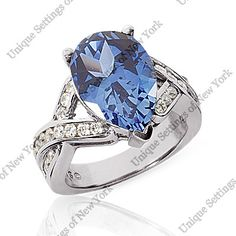 Blue Sapphire pear with diamond accents available at Jewelry Savers Wichita