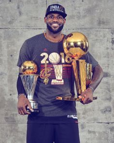 LeBron James of the Cleveland Cavaliers poses for a portrait with his MVP Trophy and the World Championship Trophy after winning the NBA Championship. King Lebron James, King James, Nba Stars, Sports Stars, Nba Finals 2016, Citations Sport, Cleveland Cavs, James Cleveland, Cleveland Rocks