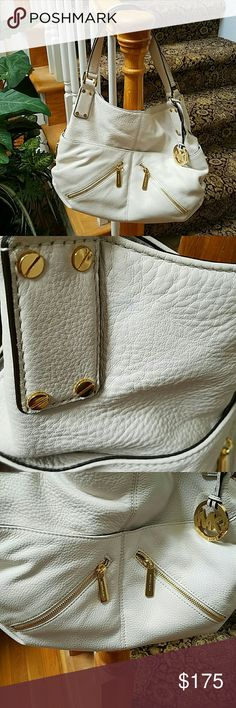 MICHAEL KORS MEDIUM SATCHEL This is an authentic Michael Kors handbag  There are utside pockets, inside zipper and carpartments for cell phone and other necessities. There a couple of pen marks I tried to remove and a couple on the strap that I didn't try to remove for fear of damage. The inside in super clean. Great color for fall. Selling because I have too many MK handbags. Did not carry this one much. Reasonable offers welcome! Michael Kors Bags Satchels