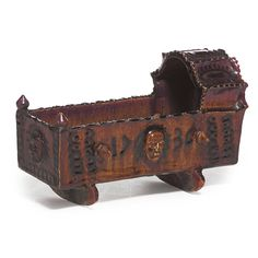 A STAFFORDSHIRE SLIPWARE CRADLE<br>1736 | Lot | Sotheby's Mocha Chocolate, English Pottery, Earthenware, 17th Century, Clocks, Medieval, Auction, Chairs, Miniatures