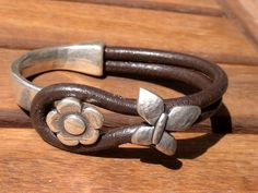 women brown leather bracelet silver plated half cuff button clasp turquoise flower finding jewellery. $26.00, via Etsy.