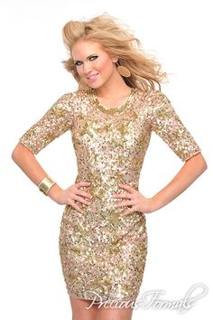 Precious Formals Style P8925 A truly elegant short hand work dress, with half sleeves and an enticing cut-out back, complete with hundreds of hand sewn sequins.