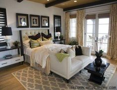 Master Bedroom Inspiration Ideas. Blue and white graphic rug and lots of light and dark neutrals. Dark Wood, beamed ceiling with darker paint on ceiling.