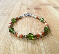 Olive Green with orange and cream glass beaded bracelet...This bracelet design and color scheme is perfect for a summer night