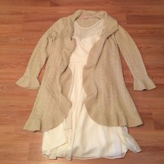 FINAL SALE Lilly Pulitzer Cashmere Cardigan A beautiful and super comfortable Lilly cashmere cable knit cardigan with gold threads running throughout, making this piece an elegant and fun layer on those fall days. Size large. There are no imperfections that I can see. I've only worn this item a few times and just doesn't fit my current style. It was a gift from a family member. As seen in the photo it also has a front closure if needed. Lilly Pulitzer Sweaters Cardigans