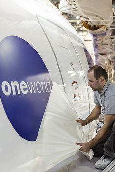 A Qatar Airways Boeing 777 receives the oneworld livery in Ireland before its official unveiling.