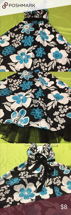 Girls floral dress. Size 10 Girls stunning dress. Size 10. Black with white and turquoise flowers. The black belt is NOT the original to the dress. My Michelle Dresses