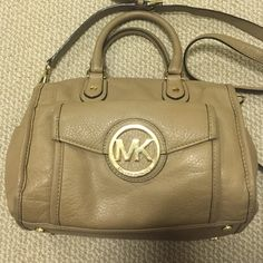 Michael Kors Purse Adorable gently used Michael Kors purse. In great condition aside from two SUPER faint red pen marks under the front flap. Barely visible!! Moving and don't have room for it. Looking for a good home  Price is firm Michael Kors Bags