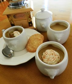 Cafe au Lait Pots de Creme  (Coffee Custard Pots) Served with crispy vanilla wafers and condensed milk chantilly.