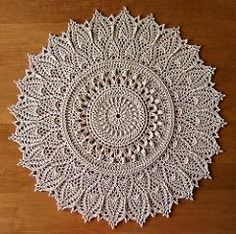 This doily is worked in 39 rounds. Use for Mandal using bright colours for each round.
