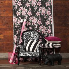 Loud and proud! These patterns go together no matter how bold they are! And how divine is that reupholstered chair with the patterned pillows? Find all of these gorgeous fabrics at http://www.marthas.co.nz