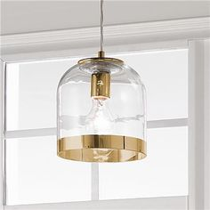 Only $139. Young House Love Metallic Rimmed Glass Pendant