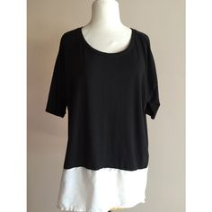 Soft black shirt with white trim Soft black tee with white sheer trim on the front. Loose fit Retro-ology  Tops Blouses