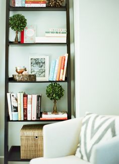 a curated shelf with greenery