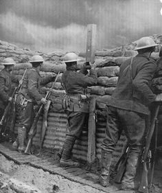 WW1 Canadian troops with the latest in steel helmets use a spyglass to check on…