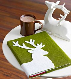 Dress up an old book and use it as a coffee table decoration! More decor ideas: http://www.bhg.com/christmas/decorating/holiday-decorating-ideas-small-spaces/?socsrc=bhgpin120513dressupabook&page=21