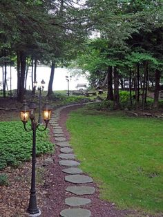"As seen on HGTV's ""Lakefront Bargain Hunt""...The backyard at Pocono Lake House is landscaped with a stepping-stone path and has vintage-look iron lamp posts to light the walkway in the evening."