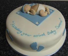 Image from http://www.cakepicturegallery.com/d/20892-2/Round+white+baby+shower+cake+with+baby+in+diapers+sleeping.JPG.