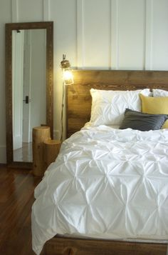 This will be my bedroom... only with a horizontal white washed pallet wall and vertical wooden pieces for my headboard. I already have the bedspread and pillows to match! :)