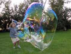 Make HUGE bubbles! We used to have a special bubble tool that we bought to do this when I was a kid but here is a tutorial on how to make your own and it's super easy and cheap.