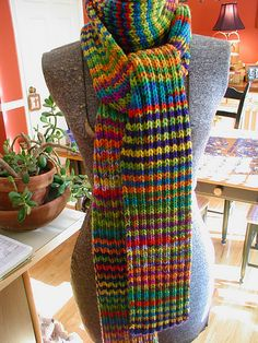 Technicolor Dream Scarf: Simple Rib Pattern alternating between two variegated yarns every two rows...