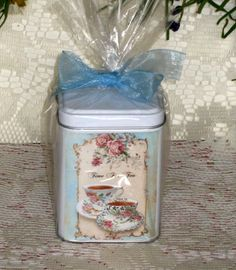 """Tea Tin with Flip Top and lovely chintz tea cup graphics. Will hold 12 teas or 4 oz. of loose tea. 3.5"""" tall by 2-7/8"""" wide. Food Safe and perfect for tea or candy."""