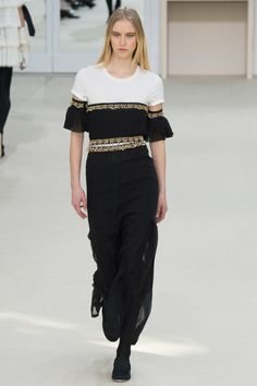 Chanel AW16 - Bardot black dress with gold embellishment to the neckline and waist worn over a white t-shirt - Paris Fashion Week...x