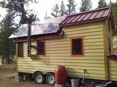 This is a very well designed tiny house by Andy Roberts. If you would like to know more on solar array installations this post by Laura on Tiny House Talk will provide you with many more of ideas and information on how they did it.