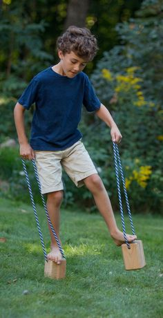 """Kids love the challenge of Walking Blocks (think of them as beginner stilts). [   """"These quirky walking blocks for kids are a great and fun challenged to master."""",   """"Wooden Walking Blocks in Outdoor Toys"""",   """"We used to make them out of cans and twine or rope."""",   """"Instant Access To Woodworking Designs, DIY Patterns & Crafts"""" . + https://br.pinterest.com/pin/560698222352746147/"""