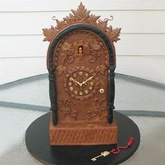 Except for the key, this clock by Ann B. of Cary, NC is made entirely of gingerbread. The grape leaves were all formed and veined by hand. Two different colors of gingerbread dough were combined to give the clock a wooden look. The gold key is made from gum paste. | thisoldhouse.com