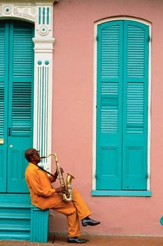 casaannabel: ca. 1990s, New Orleans, Louisiana, USA —- Saxophonist Playing Outside Building in the French Quarter