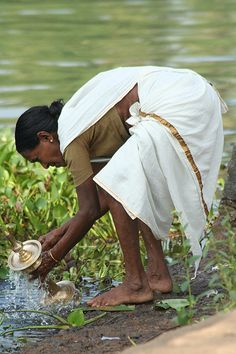 Religious Cleansing, Backwaters - Kerala.