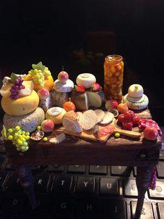 Dollhouse miniature luxury cheese display on handmade