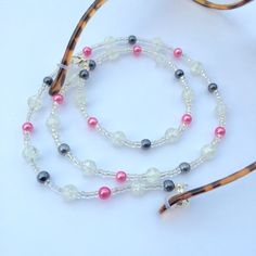 A personal favourite from my Etsy shop https://www.etsy.com/uk/listing/286993687/pearl-and-crackle-bead-eyewear-chain