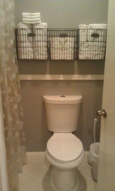 Easy DIY bathroom storage ideas for small spaces and bathroom organization hacks for organizing your bathroom on a budget. Very small bathroom storage idea - get more space in a tiny bathroom - baskets over toilet in small bathroom