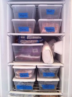 Organize Freezer with bins and removable tape.