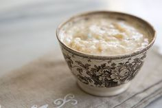 Rice Pudding ~ Classic, creamy rice pudding recipe.  Boiled rice with milk, cream, egg, brown sugar, cinnamon, vanilla, and raisins. ~ SimplyRecipes.com