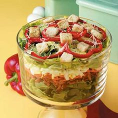 Pretty Layered Salad Recipe -A salad like this one is an appealing accompaniment to almost any dinner. You can change the mix of ingredients to include layers of your favorites. I like the tangy vinaigrette dressing with it, but ranch and other types are also very good. -Elaine Anderson Aliquippa, Pennsylvania