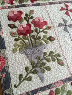 Designed and Pieced by Lisa DeBee Schiller, Quilted by Kim Norton - A Busy Bobbin