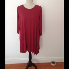 Burgandy long sleeve t shirt dress Brand new, never been worn, it's shorter than it looks on mannequin but it's an appropriate length when wearing Dresses Mini