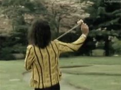 """turbanaroo: """" Freddie Mercury playing with a toy while Brian May waits his turn, Japan, 1975. """""""