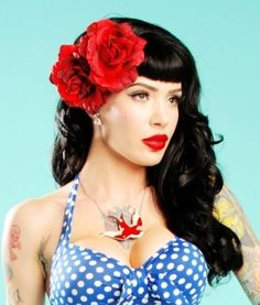This is one of my favorite tattoo jobs ever. Her left arm has been sleeved in a very classy manner.  But when you add in the polka-dotted dress, with the hair and the red roses/lip stick, you end up with June Cleaver meets Kat Von D.  Very, very sexy.