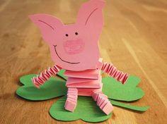 Glücksschwein mit Kleeblatt und drei andere Mehr