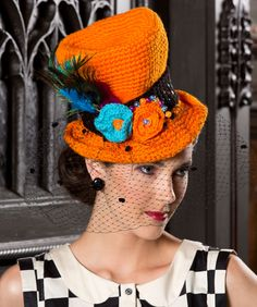 Free Halloween Top Hat crochet pattern. Super chic when embellished with crocheted flowers, netting, sequins and feathers!