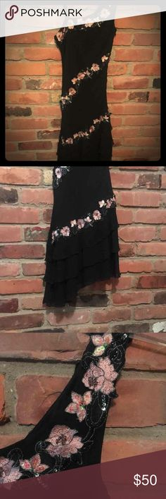 Cache little black dress Worn once. Beautiful black dress from Cache. Pink flowers with beading. Bottom of the dress is angled and layered so it twirls with you. So classy and a definite head turner. Cache Dresses Asymmetrical